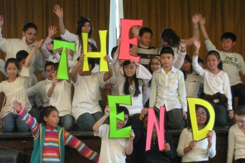 Students with The End Sign